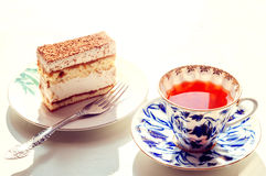 Tea with cake. Black tea with a slice of cake Stock Images