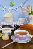 Tea and cake. In colorful vintage cups and plates stock photo