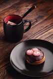 Tea and cake. In dark background Stock Images