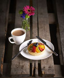 Tea and cake with flower Stock Image