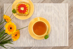 Tea with cake and flowers Royalty Free Stock Images