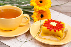 Tea with cake and flowers Stock Image