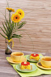 Tea with cake and flowers Stock Photos