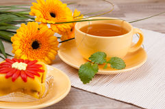 Tea with cake and flowers Stock Photography