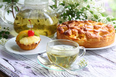 Tea, cake with fruit and a pie with a stuffing from fresh aprico Royalty Free Stock Images