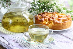 Tea, cake with fruit and a pie with a stuffing from fresh aprico Stock Photography
