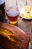 Tea, cake and lemons Royalty Free Stock Photos