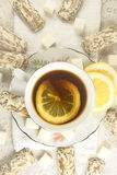 Tea with cakes, candies and lemon. Stock Images