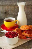 Tea and cakes, cranberries and milk Stock Photography