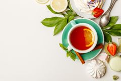 tea with cakes, and fruit on a white table royalty free stock image
