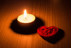 Tea candle and heart. Stock Photos