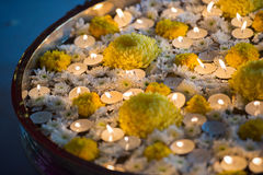 Tea candle lamps and flowers at Hindu Wedding Stock Image