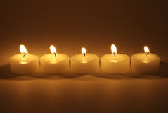 Tea Candles. Lit at night Royalty Free Stock Images