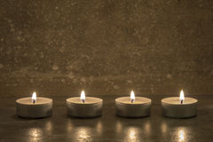Tea candles on concrete Stock Photos
