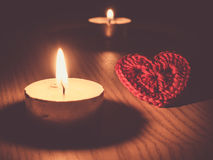 Tea candles and heart. Royalty Free Stock Images