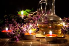 Tea candles, oil and lavender Royalty Free Stock Image