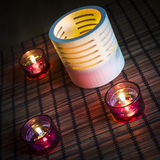 Tea candles in wood and glass Royalty Free Stock Photos