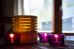Tea candles in wood and glass Royalty Free Stock Images