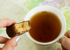 Tea and candy. A cup of tea and candy Stock Photography
