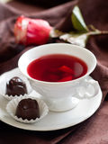 Tea with candy Stock Images