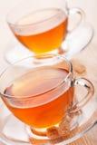 Tea and cane sugar Royalty Free Stock Image