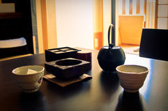 Tea Ceremony. Cups, a kettle, and green tea Royalty Free Stock Photos
