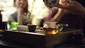 Tea ceremony in the cafe stock footage