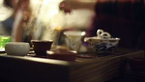 Tea ceremony in the cafe stock video footage
