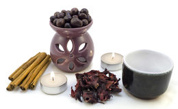 Tea ceremony by candlelight with cinnamon, roses, cup, chocolate isolated Royalty Free Stock Images