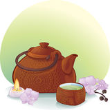 Tea ceremony with a ceramic teapot and orchid flowers Stock Photo