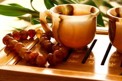 Tea ceremony. China. Onyx cup on the table. Near bamboo and beads of carnelian Stock Photo