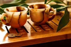 Tea ceremony. China. Onyx cup on the table. Near bamboo and coin Stock Photos