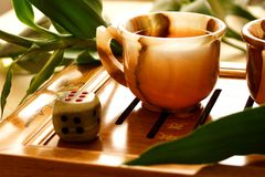 Tea ceremony. China. Onyx cup on the table. Near bamboo and dice Stock Photo