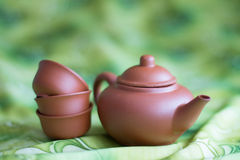 For the tea ceremony. Clay teapot and cups Royalty Free Stock Photography