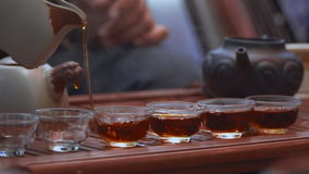 Tea ceremony close up in slow motion. Water pouring from the kettle stock footage