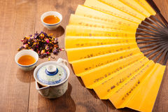 Tea ceremony composition with hand fan Stock Photo