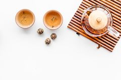 Tea ceremony concept. Tea pot, cups or bowls on white background top view copyspace Stock Photography