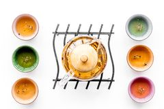 Tea ceremony concept. Tea pot, cups or bowls on white background top view pattern. Tea ceremony concept. Tea pot, cups or bowls on white background top view royalty free stock image