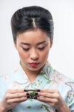 Tea ceremony conducted by Asian woman Royalty Free Stock Photo
