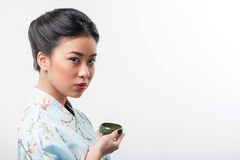 Tea ceremony conducted by Asian woman Royalty Free Stock Images