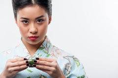 Tea ceremony conducted by Asian woman Royalty Free Stock Image
