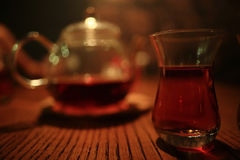 tea ceremony in dark cafe interior Stock Photos