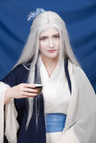 Tea ceremony From the fantasy. White hair fairytale personage on tea ceremony stock photo