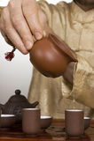 Tea ceremony. Master pouring tea during traditional Chinese tea ceremony Royalty Free Stock Photography