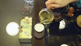 Tea ceremony. Master pours green tea from a glass teapot into a white mug.  stock video