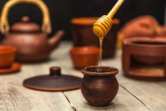 Tea ceremony, tea party. Clay dishes. Honey flows from a wooden stock images