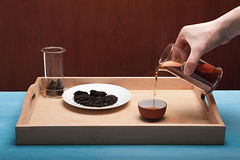 The tea ceremony: someone pours a cup of tea Royalty Free Stock Images