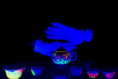 Tea ceremony in ultraviolet light Royalty Free Stock Image