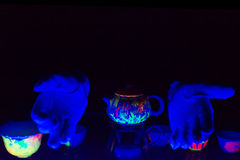 Tea ceremony in ultraviolet light Royalty Free Stock Photography