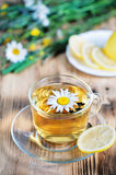 Tea with chamomile and lemons Stock Photo
